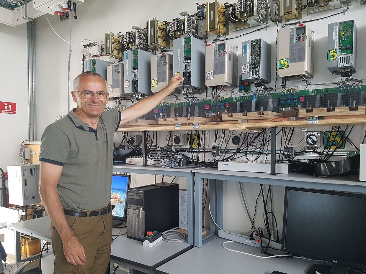 2019 Global Energy Prize laureate Danish professor Frede Blaabjerg in front of a wall of power electronics