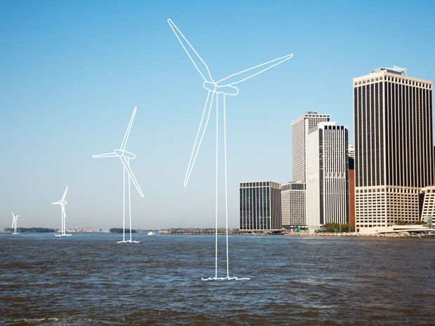 A city skyline with imaginary wind turbines just off shore.