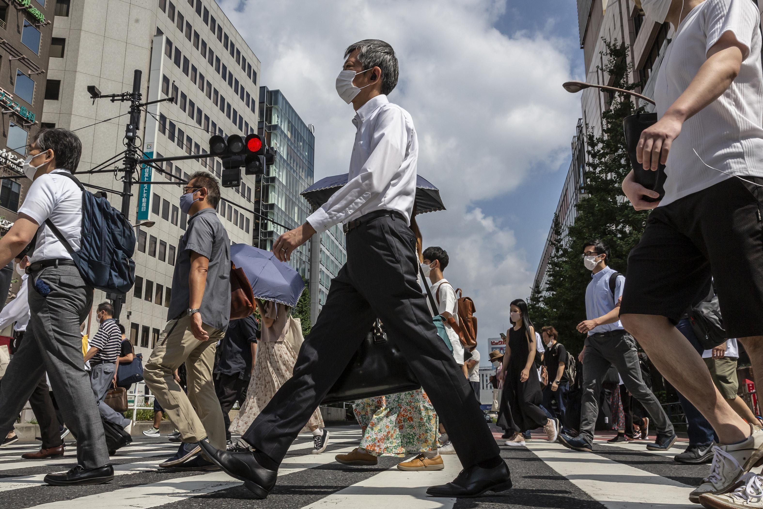 A crowd of people in Japan crossing the street