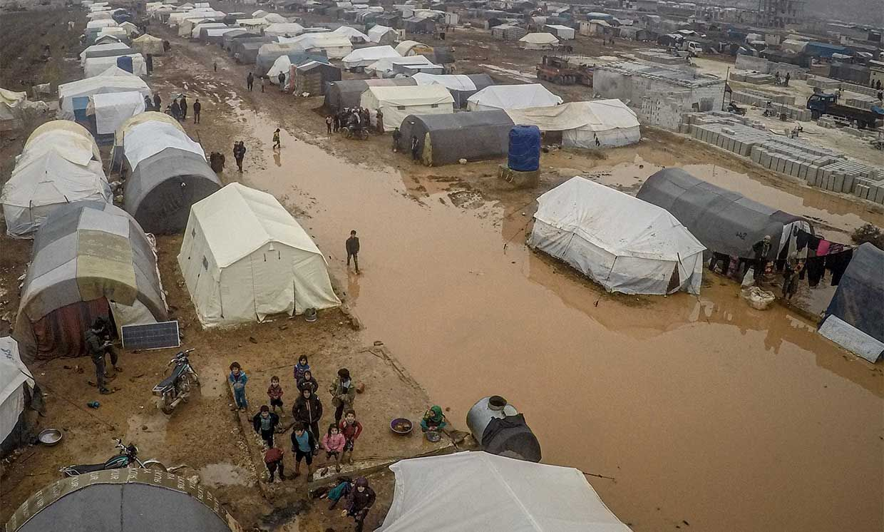 A drone photo shows an aerial view of the mud covered road and tents at a refugee camp, where Syrian refugees live, after heavy rain at winter season in northeastern Idlib, Syria on December 13, 2019.
