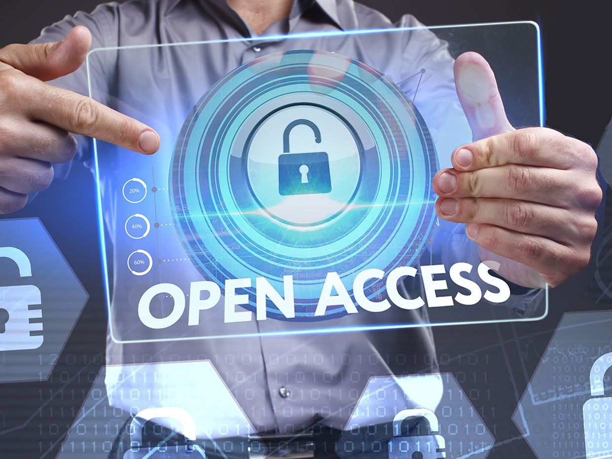 A man points to a clear tablet with the words open access and an unlocked lock icon on it.