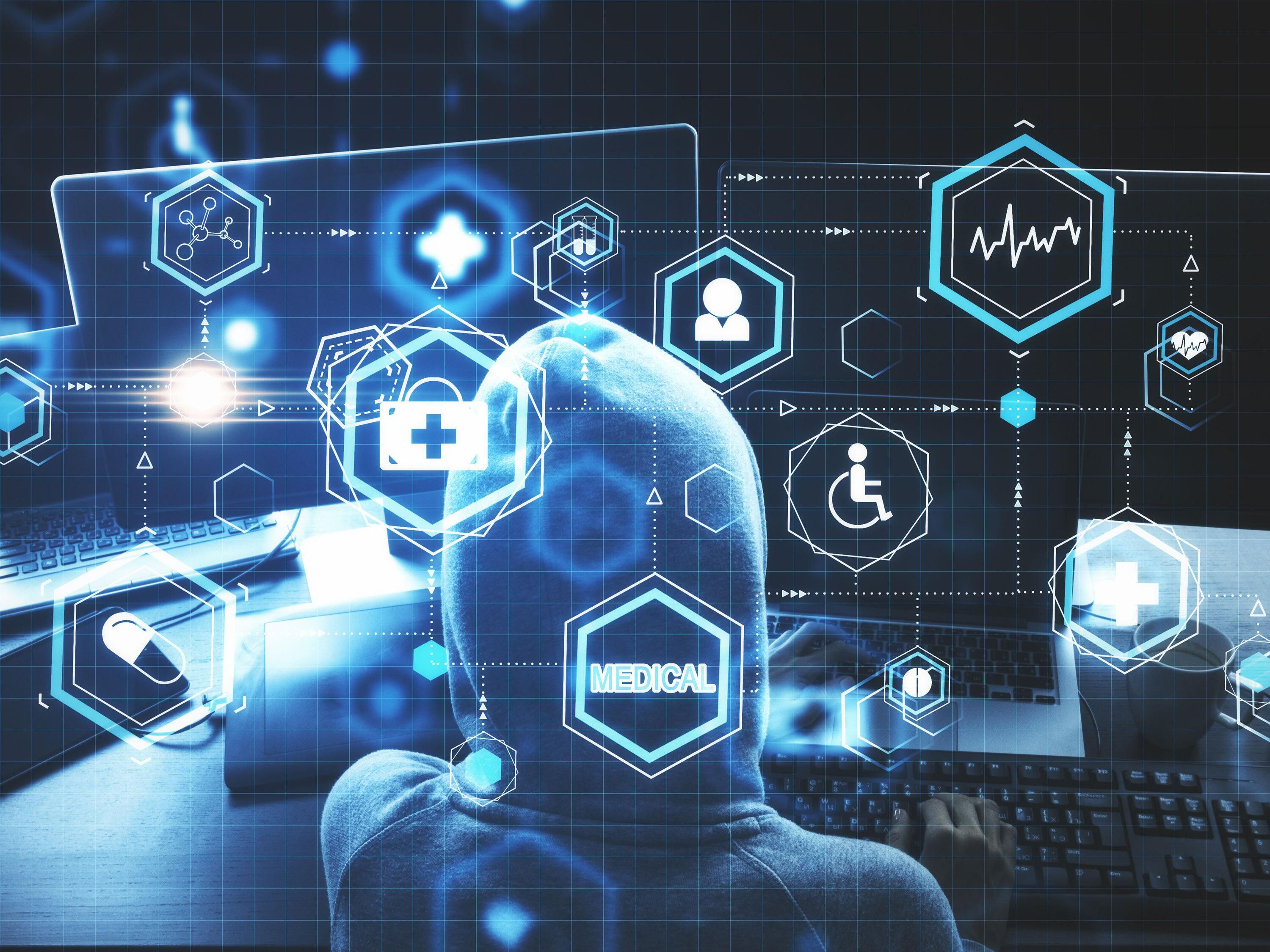 A person in front of a computer with medical based icons all around them.