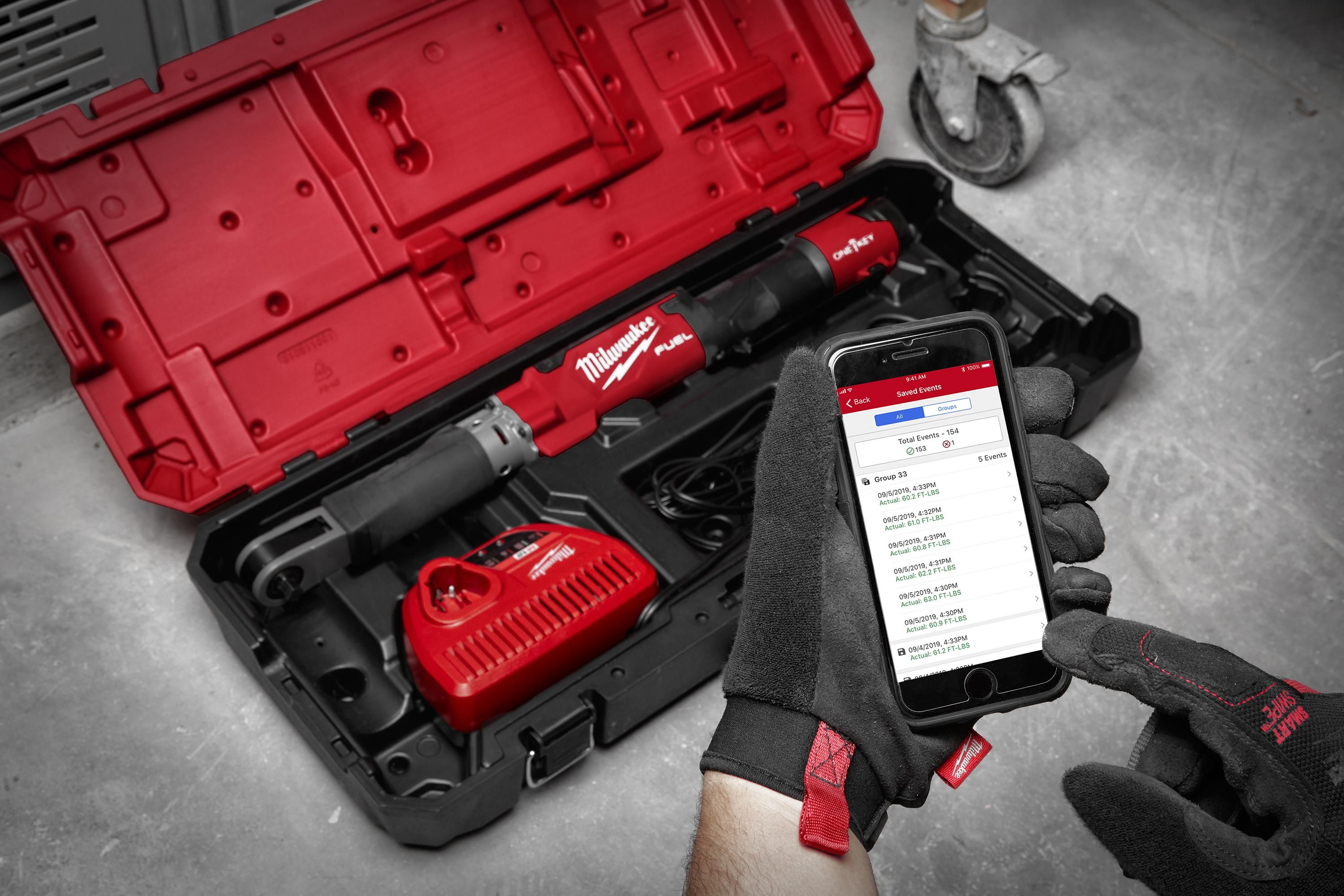 A person operates a smartphone app that connects with Milwaukee Tool hardware