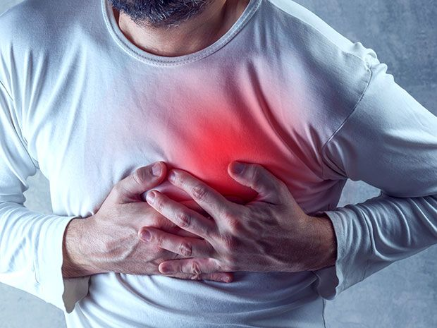 A photo-illustration shows a man clutching his chest, which is emitting a red glow to indicate a heart attack.