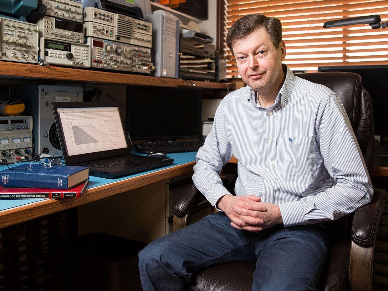 A photo of Mats Järlström sitting at a desk next to a laptop.