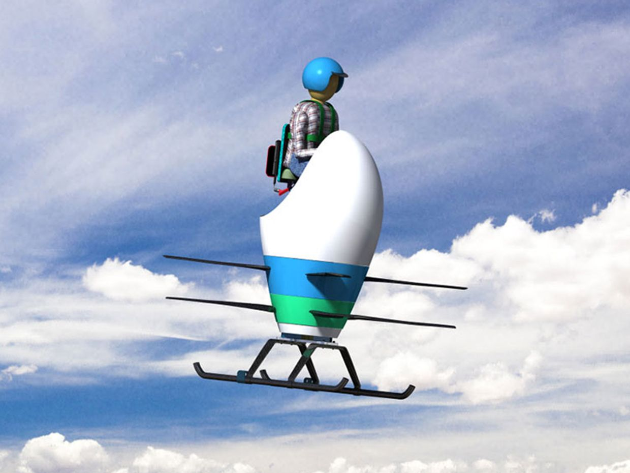 A pilot wearing a helmet steers an egg-shaped personal flying vehicle across the sky.