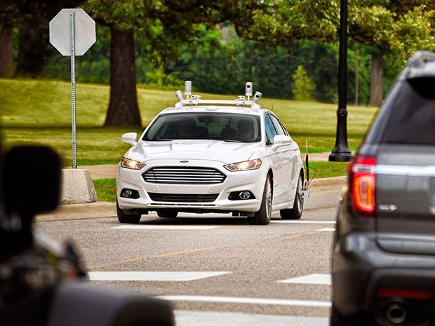 A self-driving Ford Fusion with lidar sensors on roof.