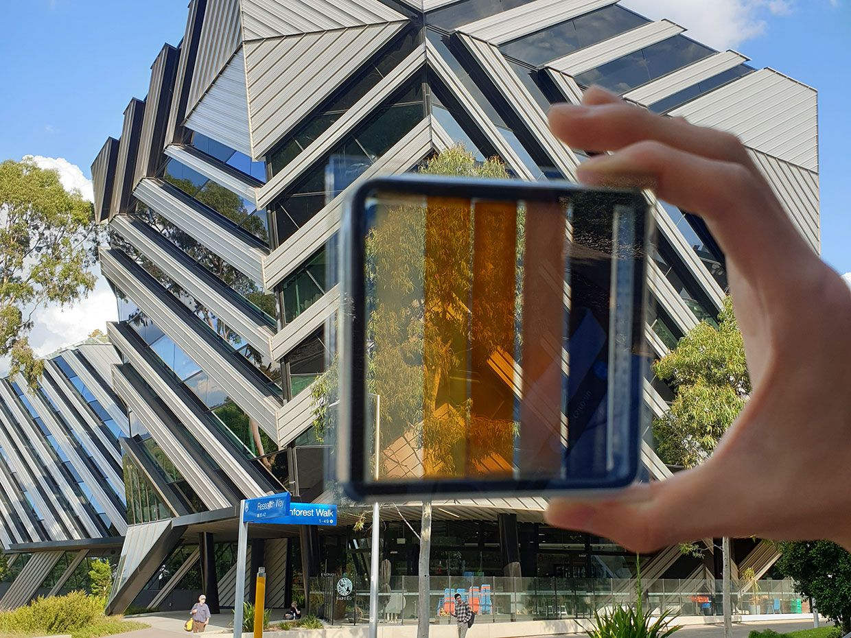 A semi-transparent perovskite solar cell with contrasting levels of light transparency.