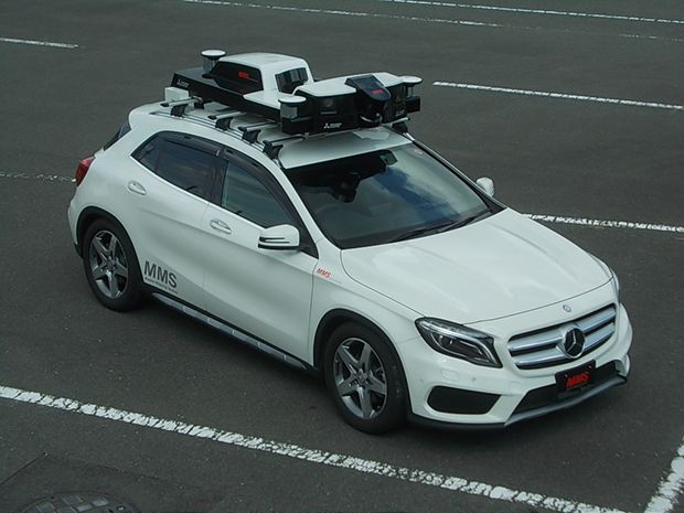A vehicle sporting a roof-mounted mobile mapping unit prepares to capture the data that will let cars safely drive themselves
