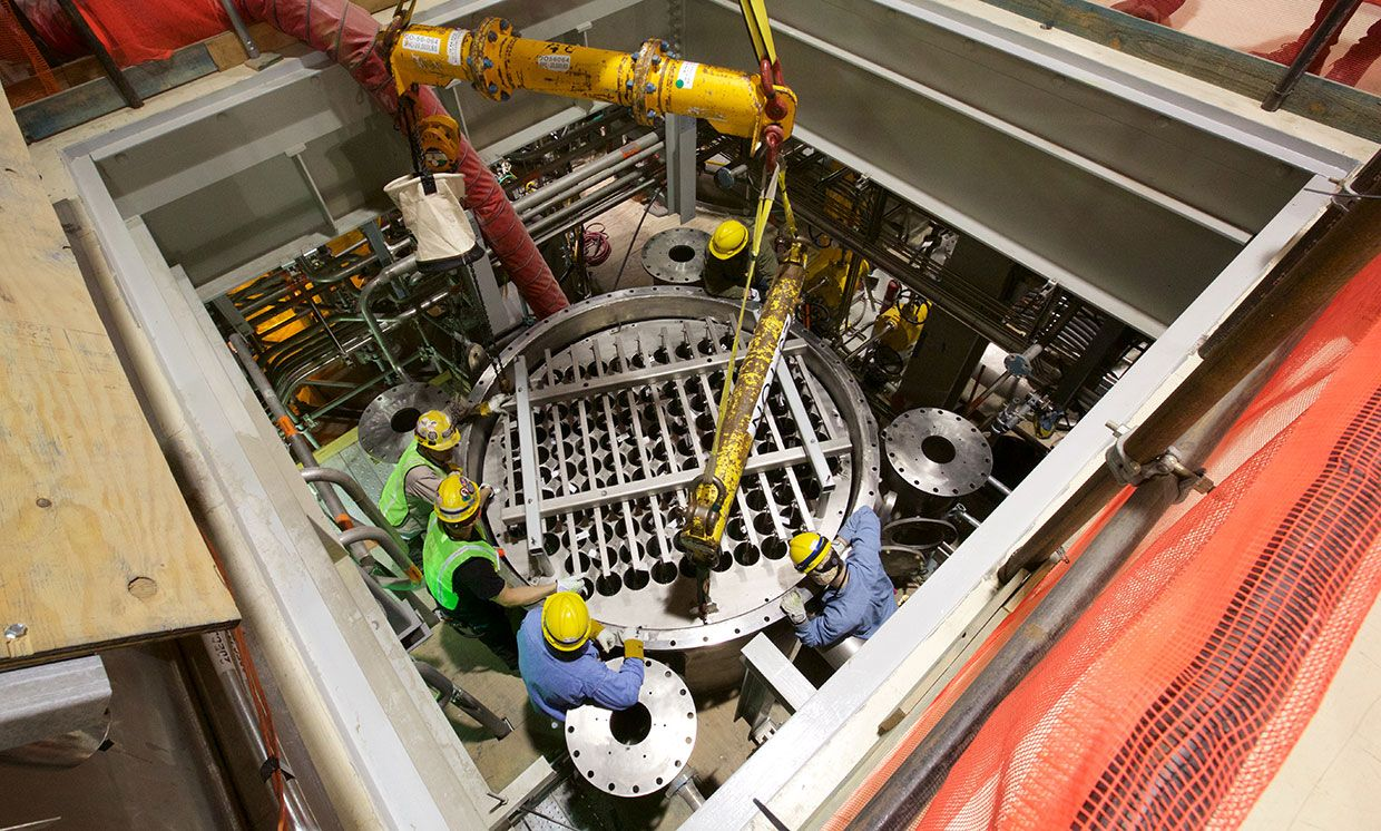 A wet electrostatic precipitator bundle is lowered into a vessel in the Low-Activity Waste Vitrification Facility at the Hanford Vit Plant.