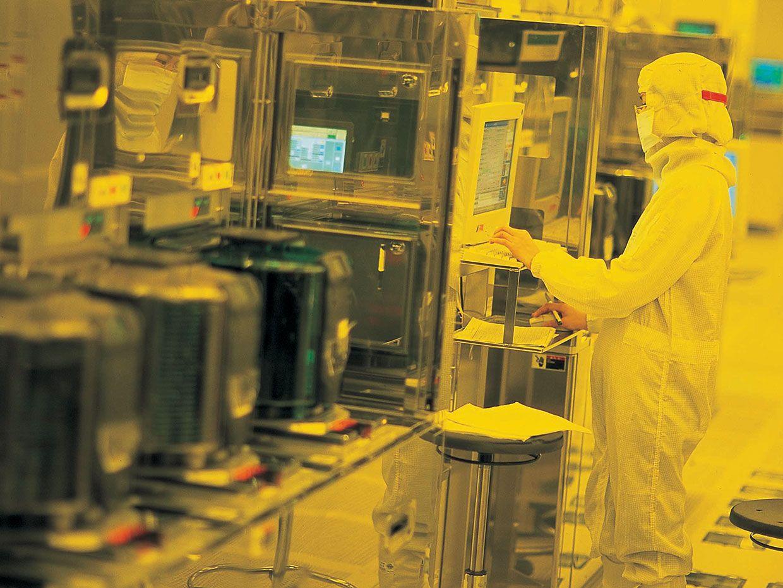 A worker inside a TSMC fab