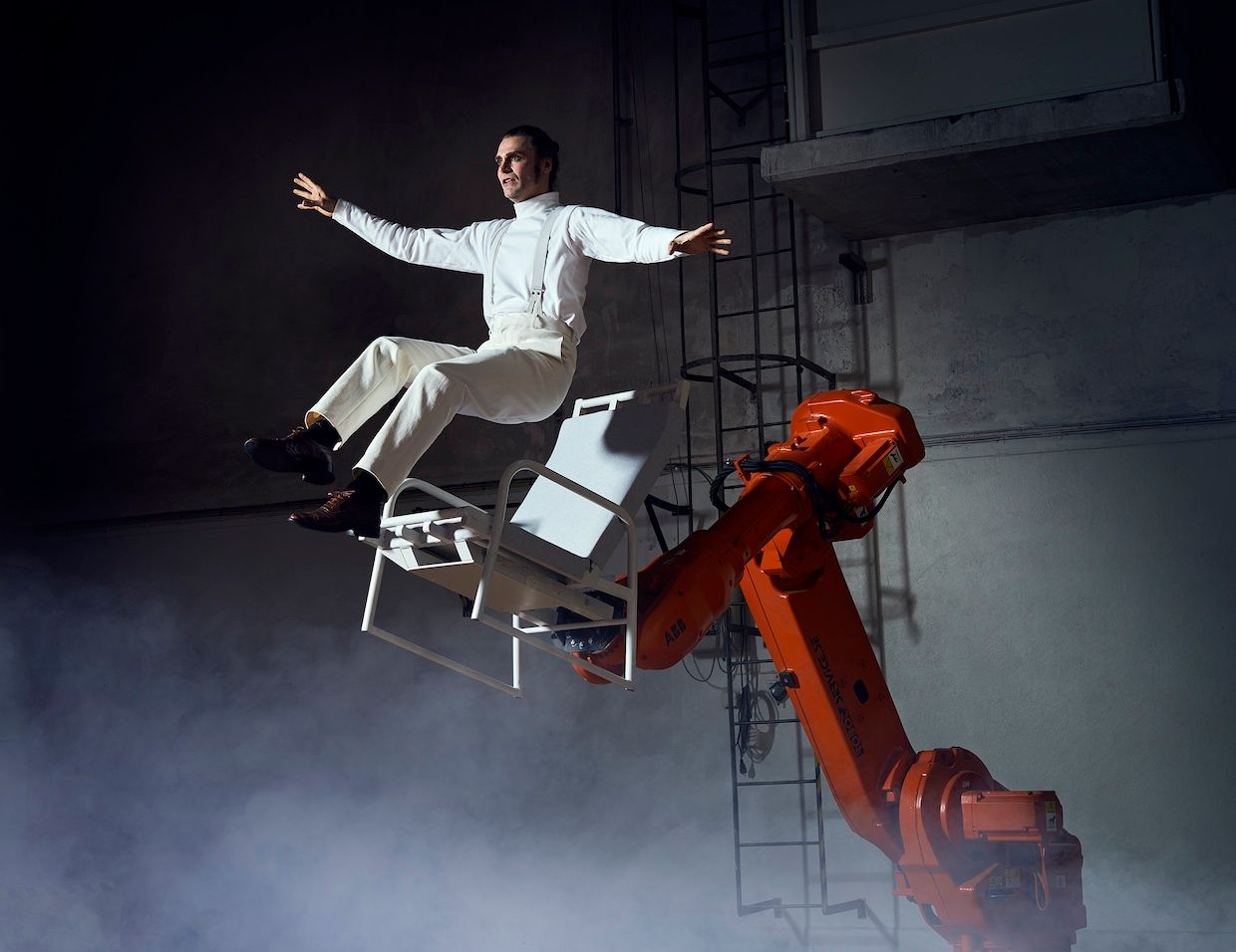 """Acrobat Mattias Lindström interacts with an industrial robot during the performance of """"The Last Fish."""""""