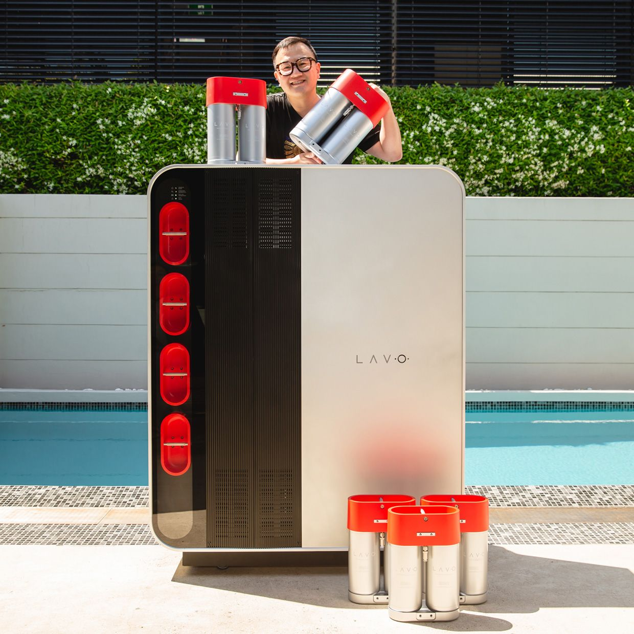 """Alan Yu, CEO of Lavo, with his company's """"hydrogen battery"""" technology. The residential unit, shown here, can store up to 40 kilowatt-hours of energy."""