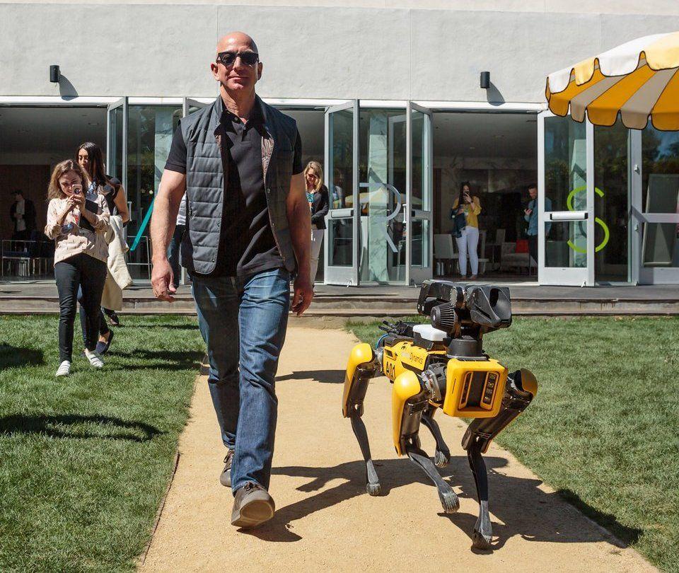 Amazon CEO Jeff Bezos with Boston Dynamics' SpotMini robot