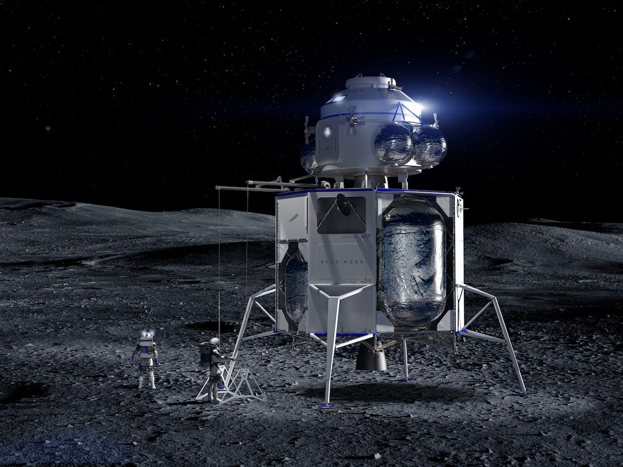 An artist's conception shows two astronauts standing on the moon next to a metallic lander consisting of four legs, a boxy midsection, and a rounded module on top.