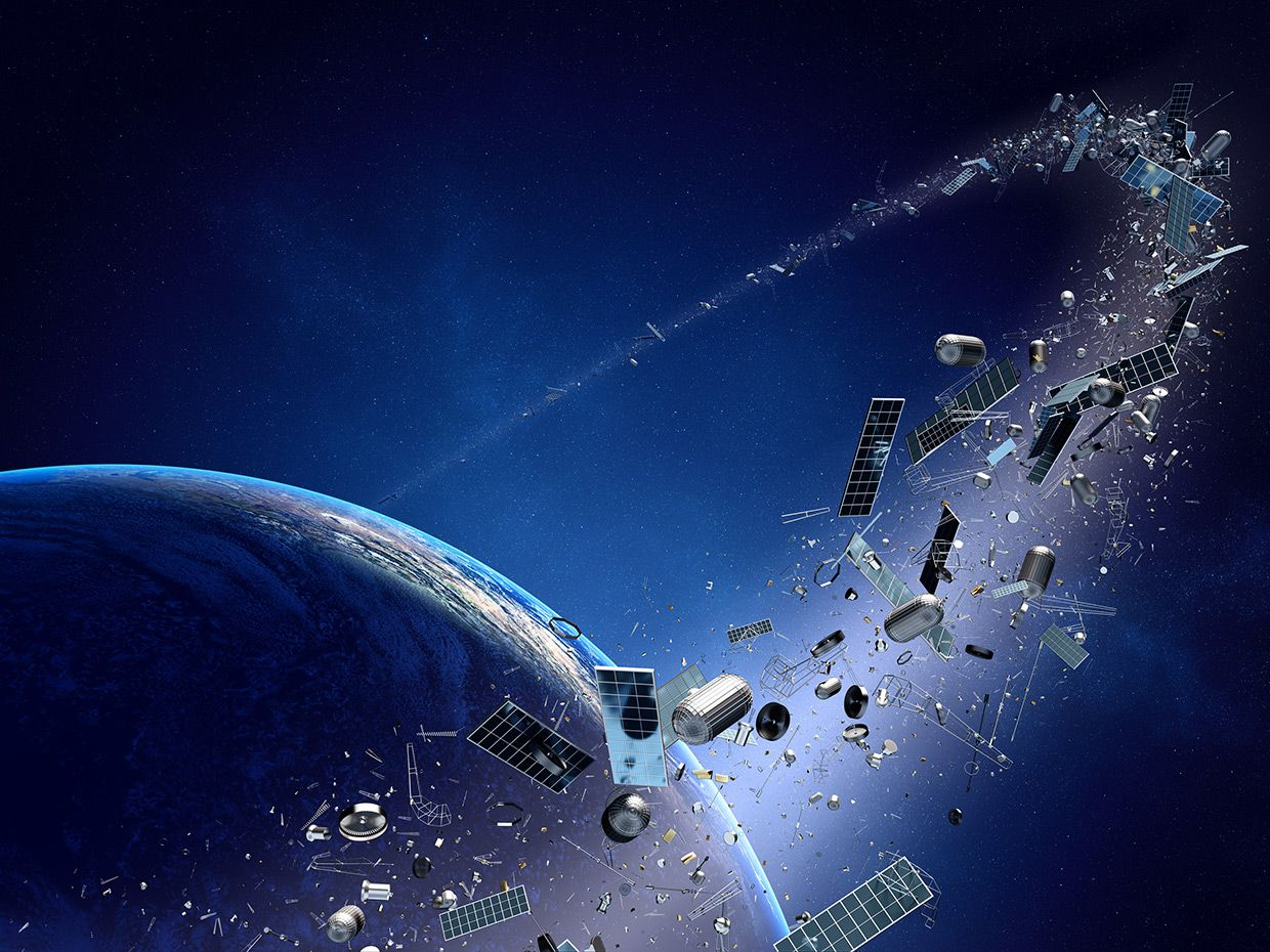 An illustration shows a string of space debris in orbit.