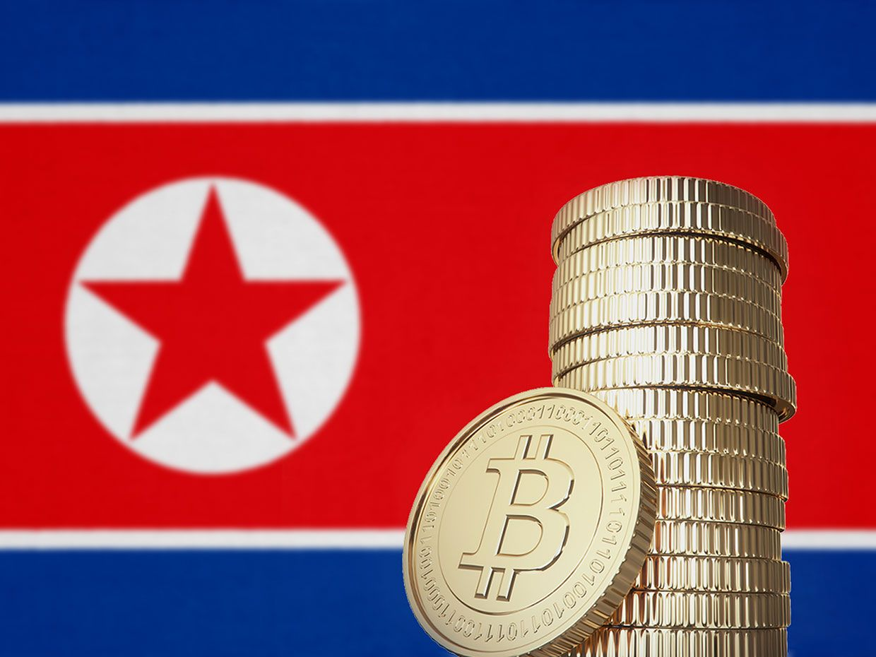 Bitcoins in front of a North Korea flag