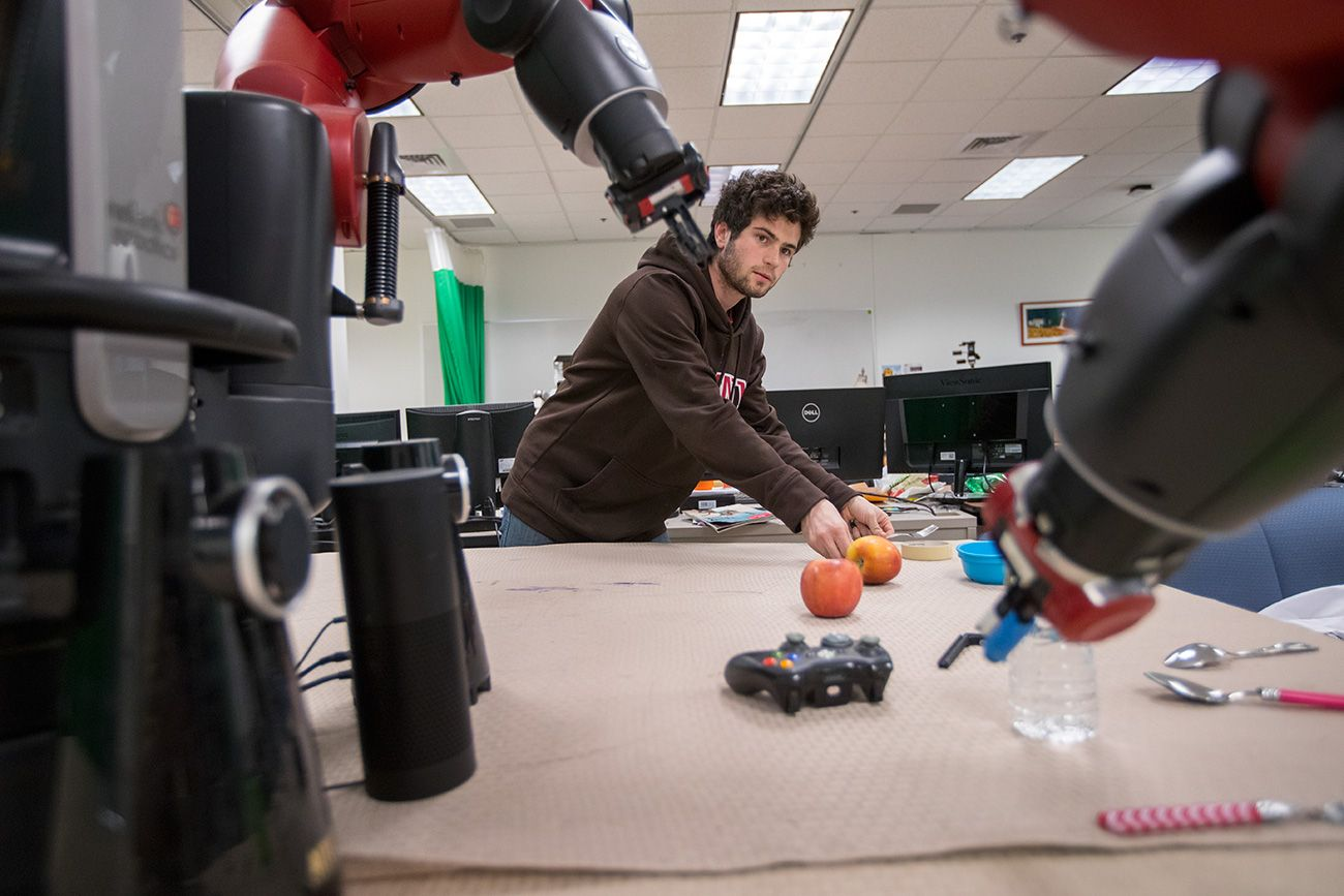 Brown University researcher works with a Baxter robot.