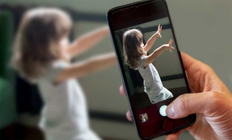 Caregivers record child's natural behavior at home through Cognoa's parent-facing mobile app, one component of Cognoa's autism diagnostic device.