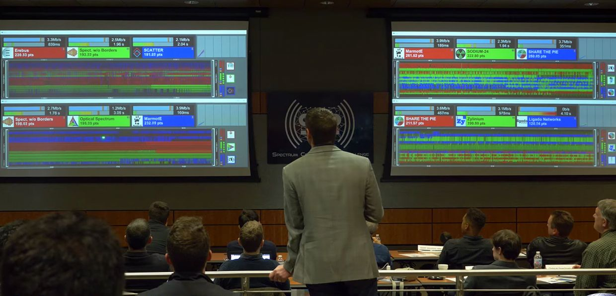 DARPA's Paul Tilghman presides overs the Spectrum Collaboration Challenge preliminary event on December 13, 2017.
