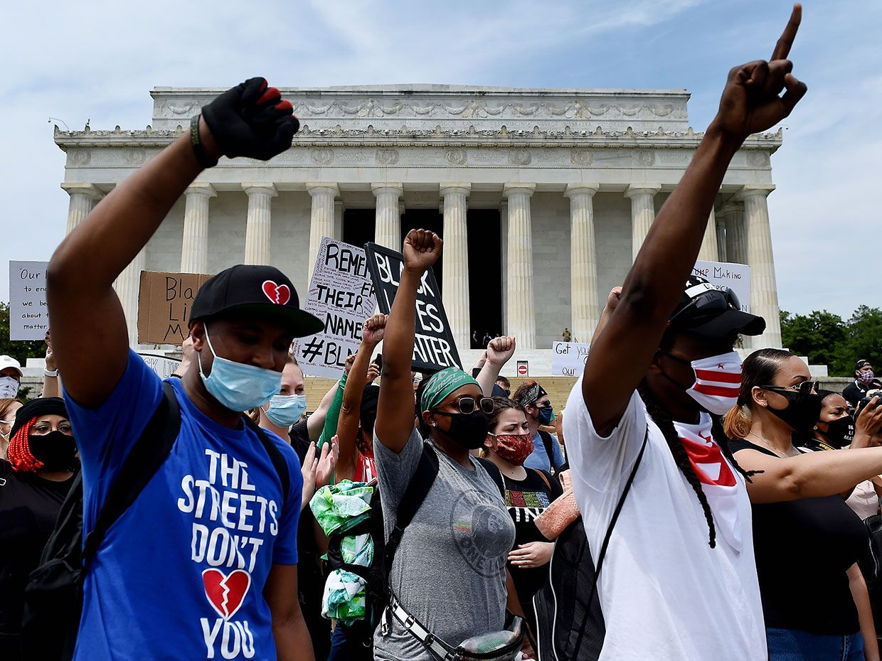 Demonstrators raise their fists at the Lincoln Memorial during a protest against police brutality and racism on June 6, 2020 in Washington, DC.