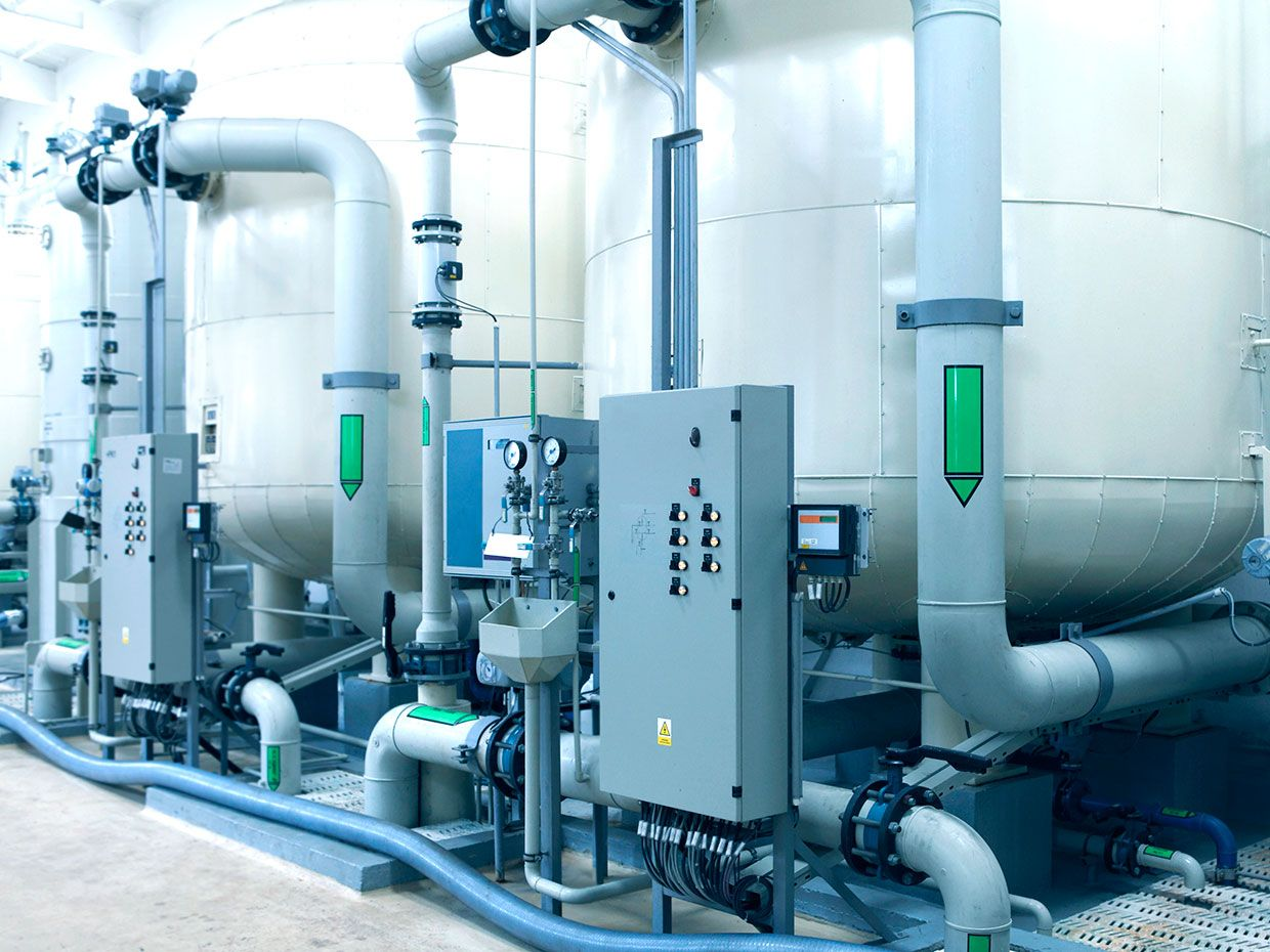 Detail of water cleaning plant: large filters (canisters), pipelines and electronics switchboards
