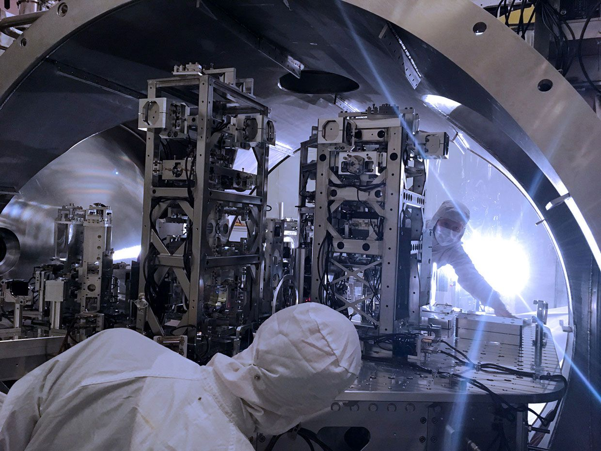 Detector engineers  are pictured here beginning the hardware upgrades inside the vacuum system of the detector at LIGO Hanford Observatory,