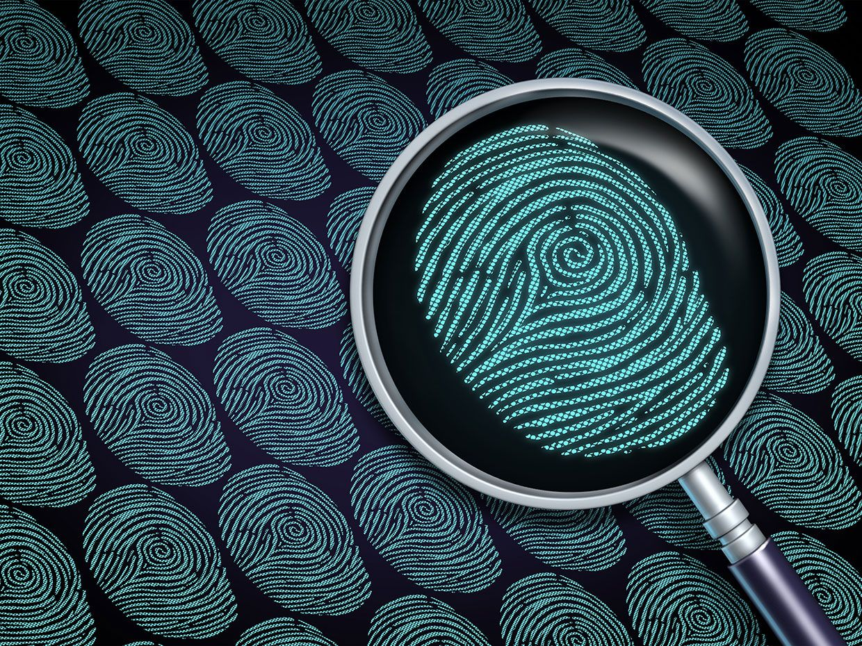 Digital fingerprints with a magnifying glass over one of them.