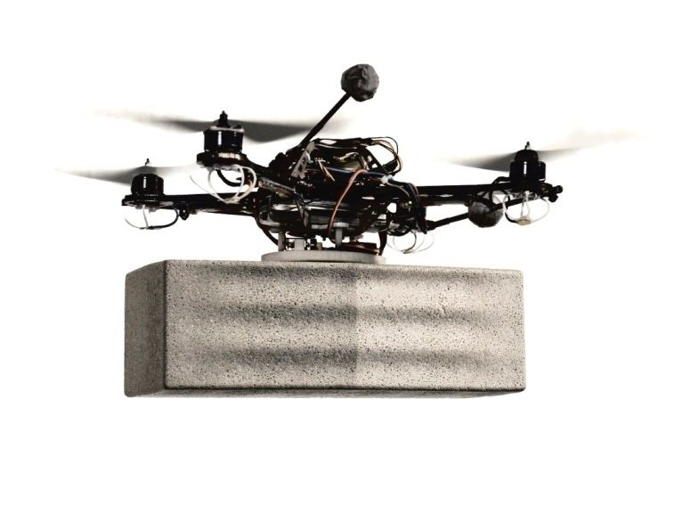 Drones carry bricks to build a wall