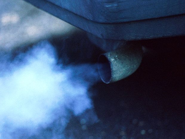 Exhaust comes out of the tailpipe of a vehicle