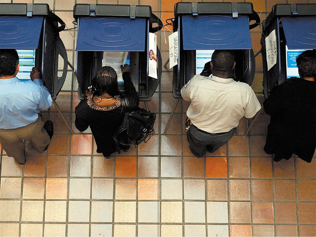 Overhead shot of people voting in voting booths.