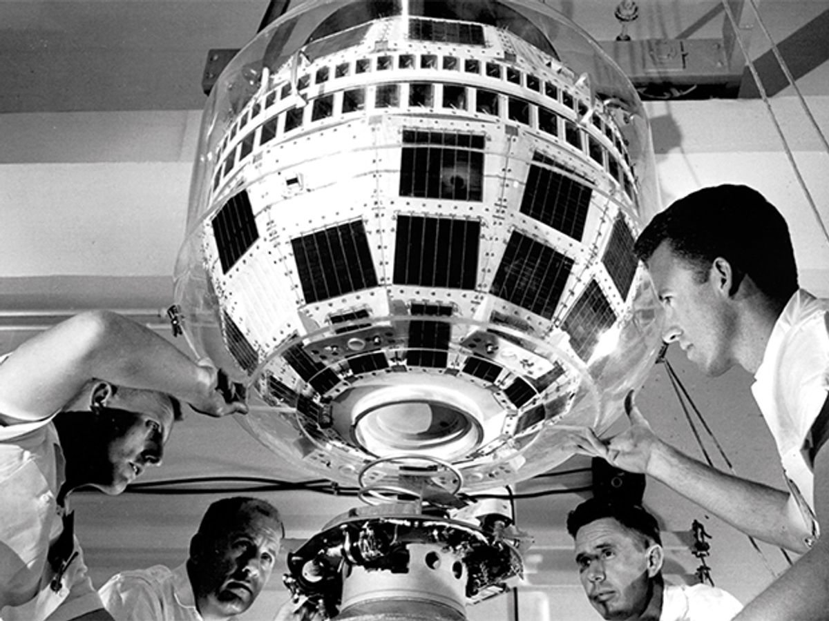 Technicians attach the 77-kilogram Telstar 1 satellite to a launching rocket for its journey into orbit in 1962.