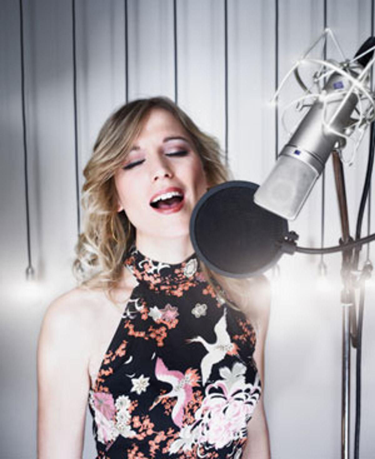 Photo of woman singing.