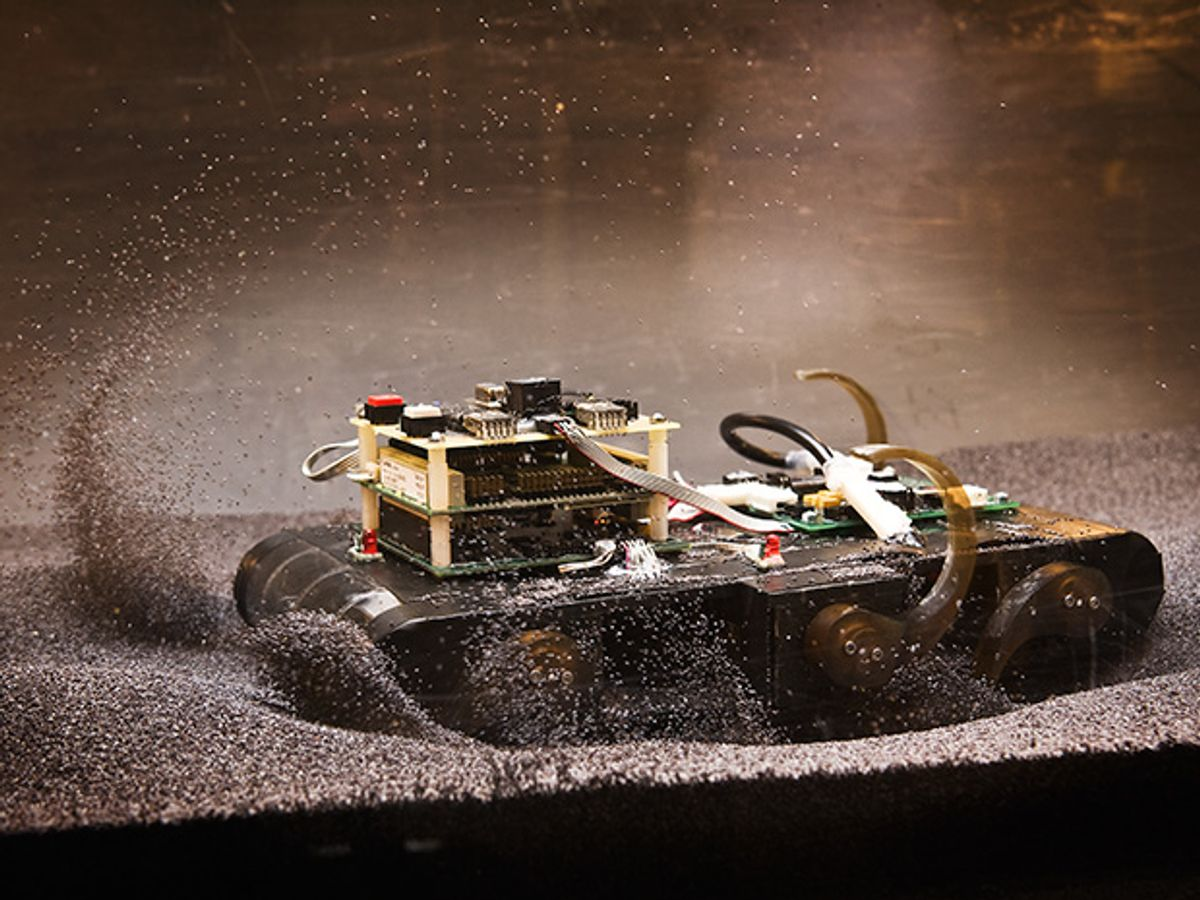 Photo of Sandbot as it trundles down a track filled with poppy seeds.