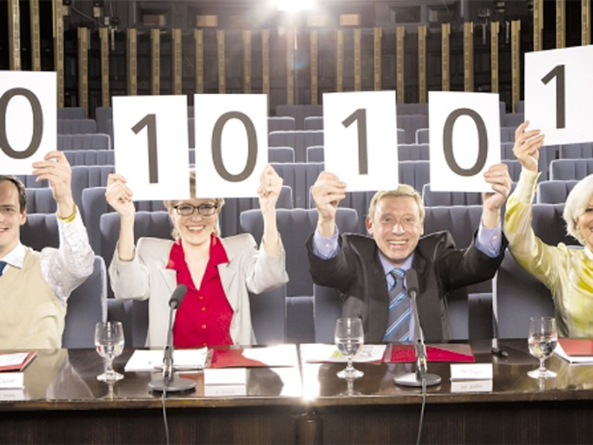 stock photo of people holding up cards with numbers