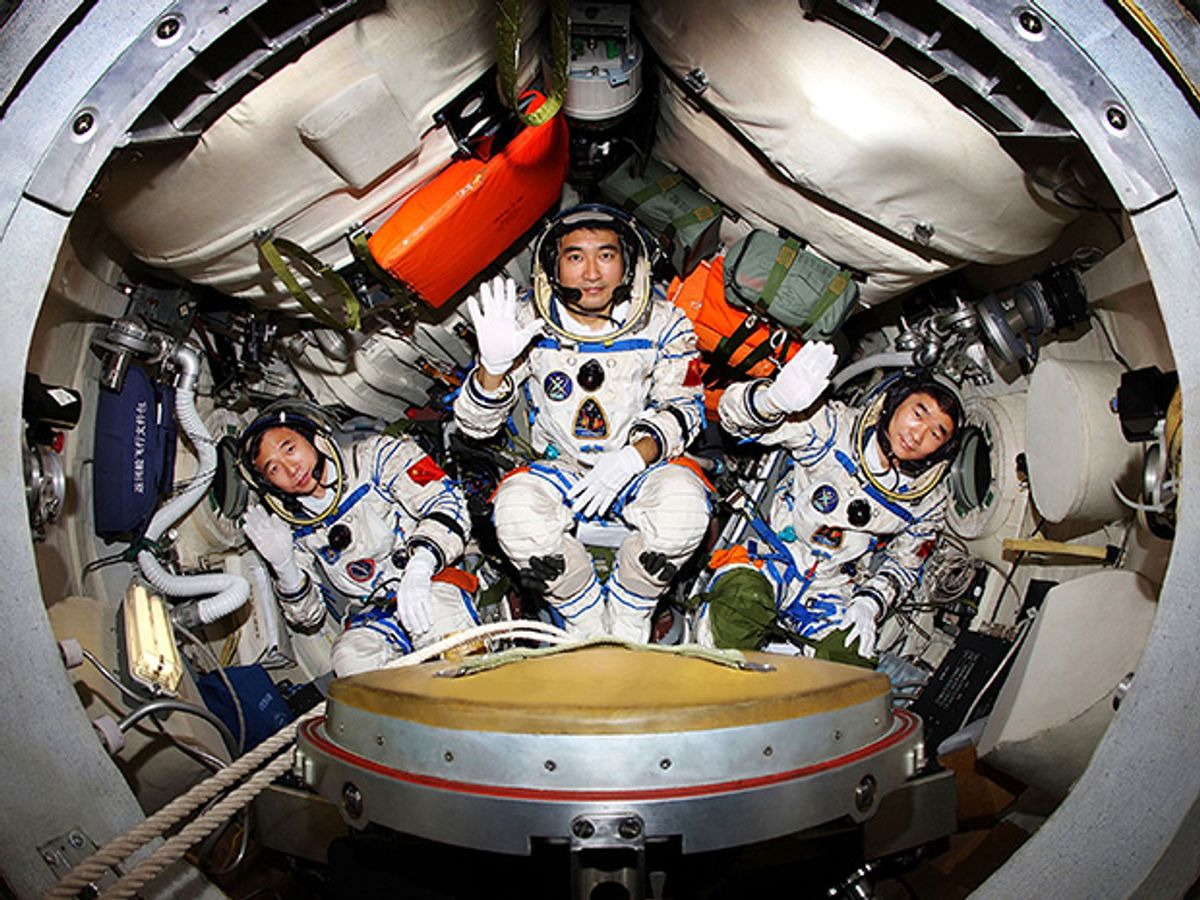 Taikonauts prepare for China's first three-person spaceflight.