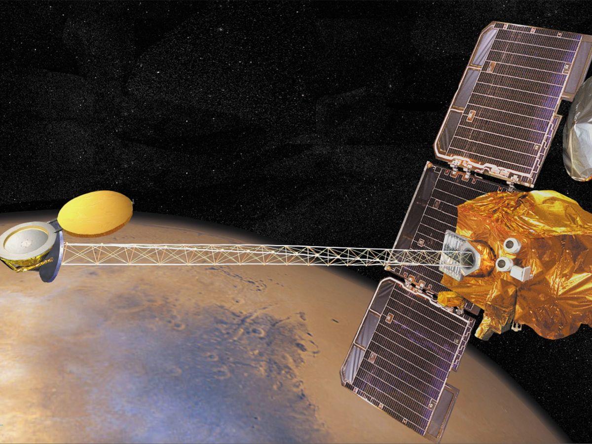 An artist's impression of the Odyssey spacecraft in orbit around Mars.