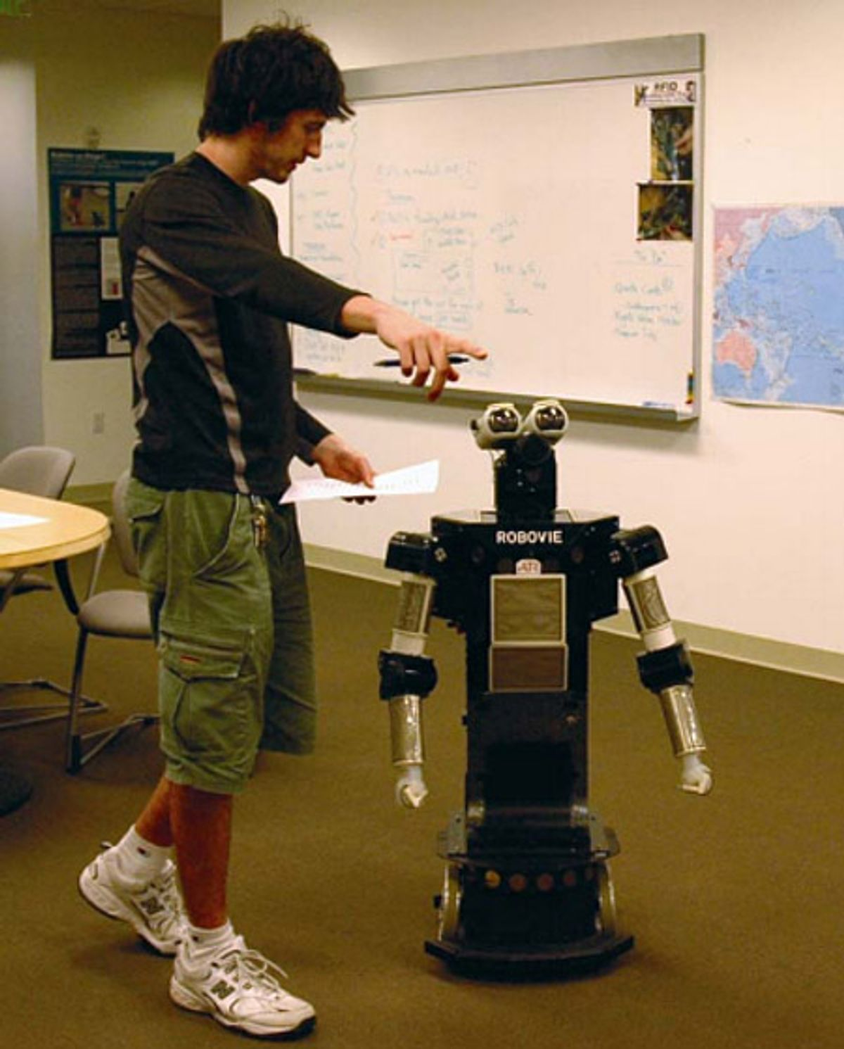 Photo of human with robot.