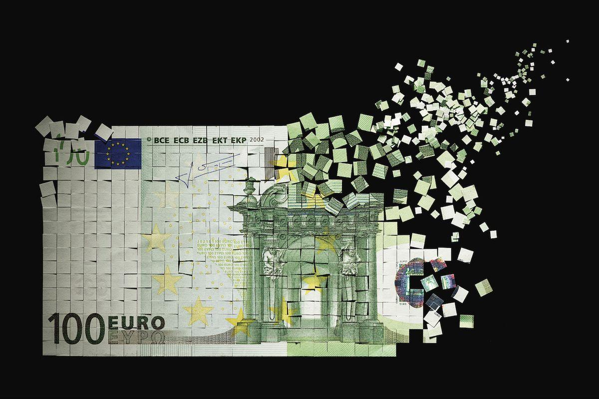 Image of Euro bill breaking apart.