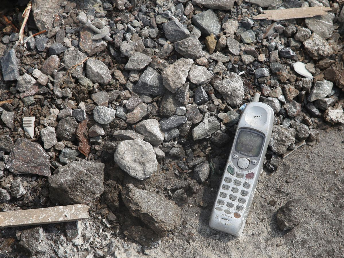 A mobile phone left in the rubble in Yamada, Japan after the 11 March 2011 earthquake