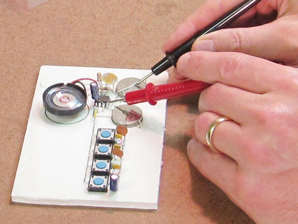 Photo of someone soldering.