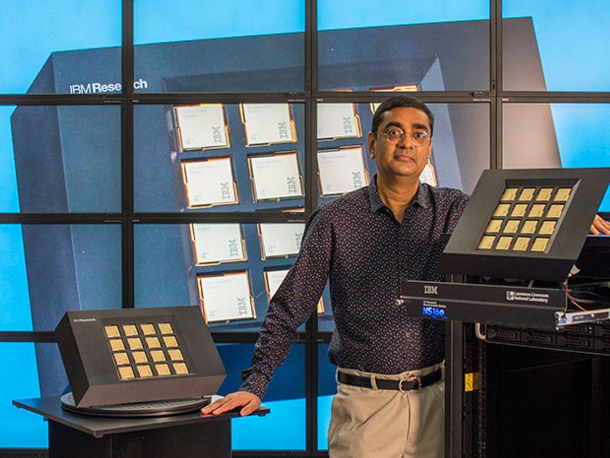 IBM's Dharmendra Modha poses with TrueNorth chips