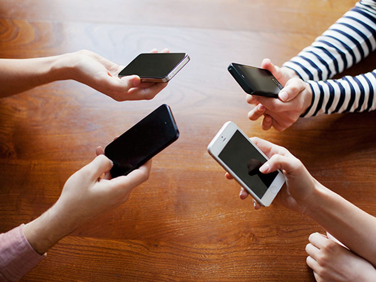 Human arms holding smartphones