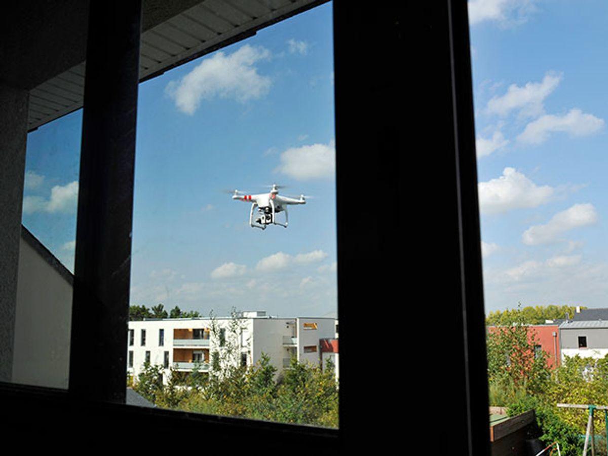 Quadcopter flies close to a window