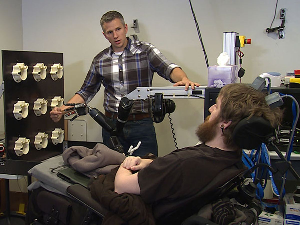 Nathan Copeland participating in an experiment where a robotic hand is pressed and he feels the sensation of touch