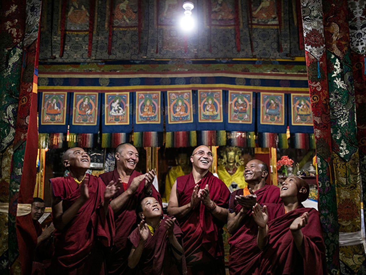 Group admiring LED light.