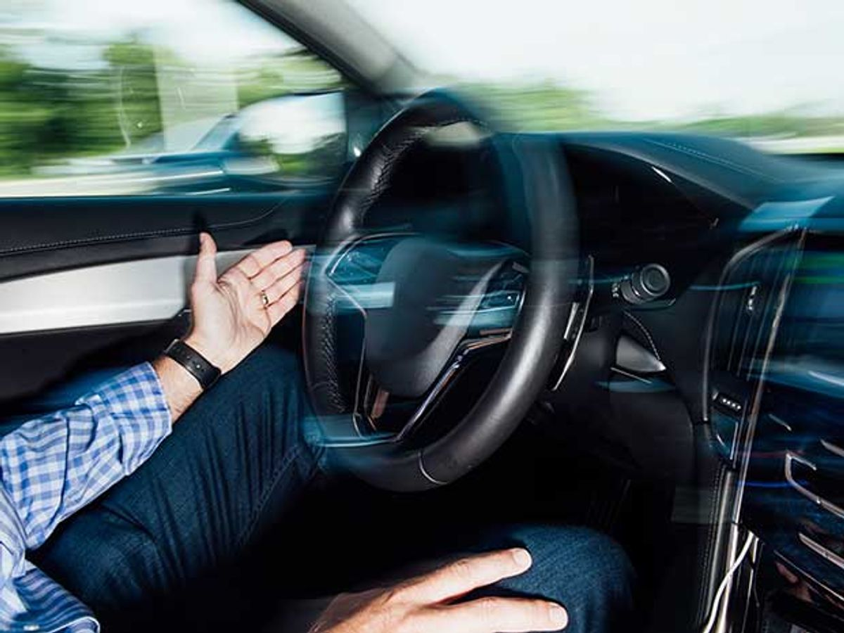 photo of driver with hands off the steering wheel
