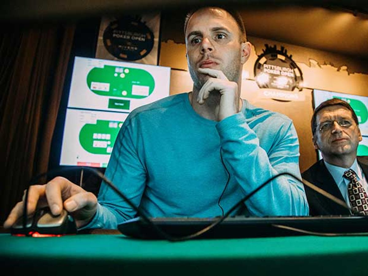 Poker pro Jason Les with computer mouse in hand plays against the Libratus AI