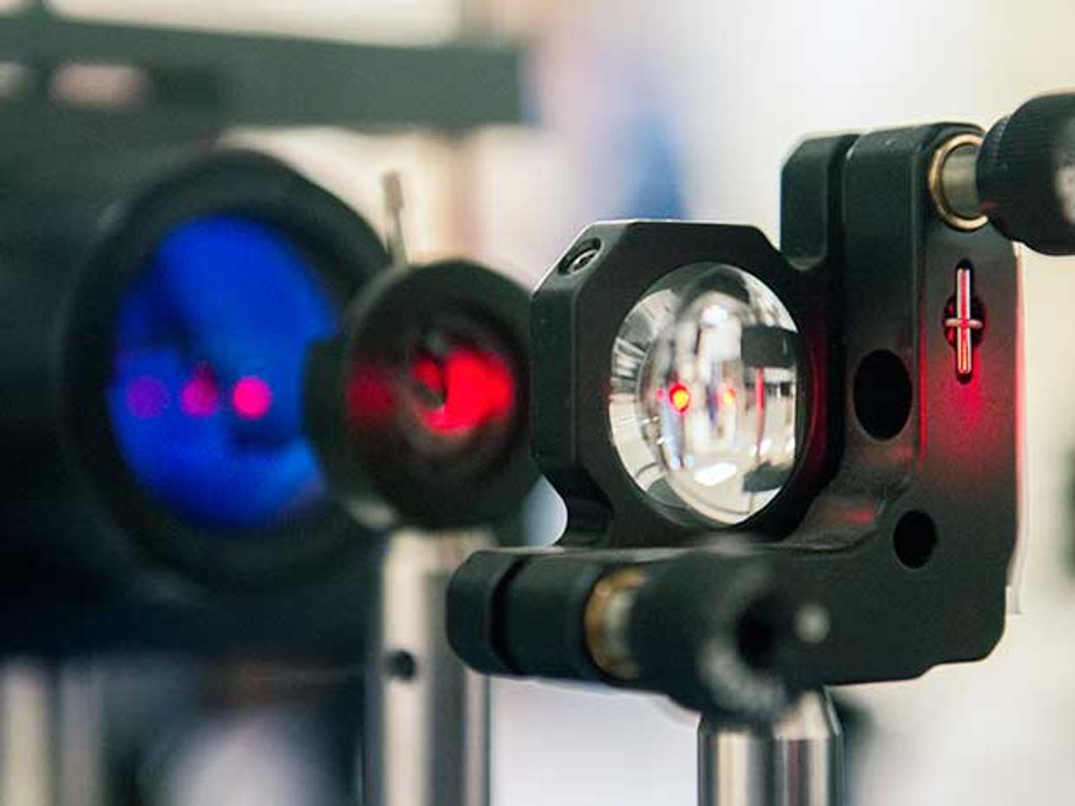 An experimental setup shows a close-up of an infrared laser as it travels through a lens
