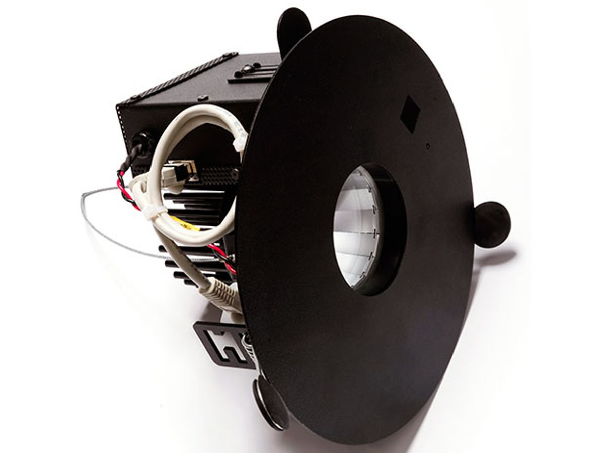 The components of a new integrated luminaire by PureLiFi are shown from a side view, with a black ring around the light itself.